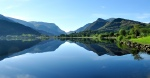 """Mirror image sunrise on Padarn lake"" by Hefin Owen"